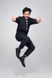 Active young handsome asian man. Cool fashion male model jumping Royalty Free Stock Photos