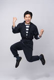 Active young handsome asian man. Cool fashion male model jumping Stock Photos