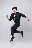 Active young handsome asian man. Cool fashion male model jumping Stock Images