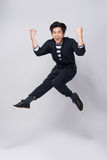 Active young handsome asian man. Cool fashion male model jumping Stock Photo