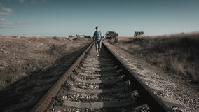 Active young healthy man running on railroad during outdoor leisure sport activity run