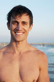 Active young man at the beach Stock Images