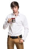 Active young man drinking tea Royalty Free Stock Photos