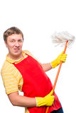 Active young man having fun with a mop Royalty Free Stock Photography