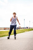 Active young man rollerskating outdoor. Stock Photo