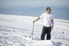 Active young man shoveling snow Stock Photo
