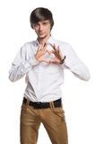 Active young man showing his hands Stock Photo