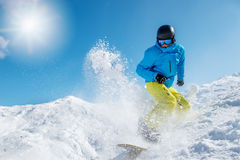 Active young man snowboarding Royalty Free Stock Photo