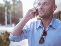 Active young man talking on the mobile phone Stock Photography