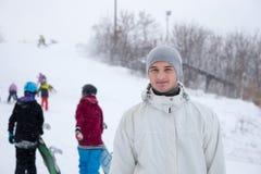 Active young man at a winter ski resort Stock Images