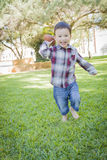 Active Young Mixed Race Toddler Playing Football Outside Stock Photography