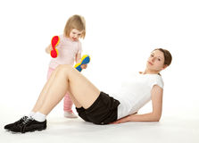 Active young mother and her little daughter Stock Images