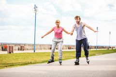 Active young people friends rollerskating outdoor. Stock Image