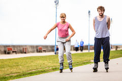 Active young people friends rollerskating outdoor. Stock Photo