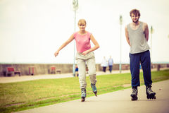 Active young people friends rollerskating. Royalty Free Stock Image