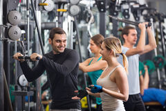 Active young people having weightlifting training Royalty Free Stock Photography