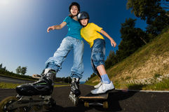 Active young people - rollerblading, skateboarding Stock Image