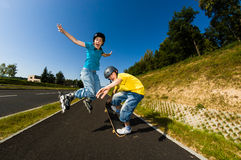 Active young people - rollerblading, skateboarding Stock Photos