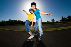 Active young people - rollerblading, skateboarding Royalty Free Stock Photo