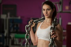 Free Active Young Strong Sports Woman With Heavy Chain Stock Images - 100983684