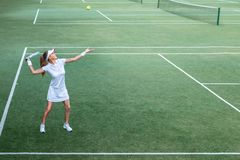 Active young woman on the court. Active young woman on the tennis court stock photos