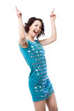 Active young woman dancing in short shiny blue dress. Excited young female dancer in short sparkling blue dress, having fun, clubbing, dancing disco, pointing stock images