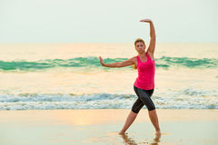 Active young woman doing exercises Stock Image