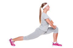 Active young woman doing stretching Royalty Free Stock Photography