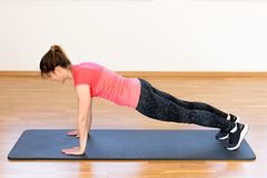 Active young woman exercising. At the gym Royalty Free Stock Image
