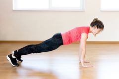 Active young woman exercising. At the gym Royalty Free Stock Images