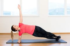 Active young woman exercising. At the gym Stock Photo