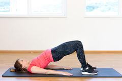 Active young woman exercising. At the gym Stock Images