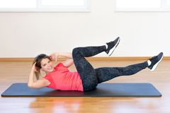 Active young woman exercising. At the gym Royalty Free Stock Photos