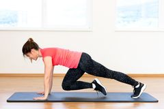 Active young woman exercising. At the gym Royalty Free Stock Photography