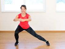 Active young woman exercising. At the gym Royalty Free Stock Photo