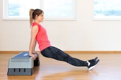 Active young woman exercising. At the gym Stock Photography