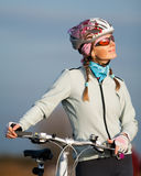Active young woman with her bicycle Royalty Free Stock Photos