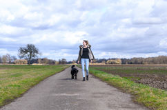 Active young woman jogging with her pet dog royalty free stock photography
