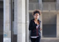 Active young woman jogging in urban environment Stock Image