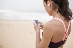 Active young woman listening to music in headphones.  Royalty Free Stock Image