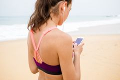 Active young woman listening to music in headphones.  Royalty Free Stock Photos