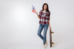 Active young woman representing American nation in the studio stock photos