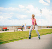 Active young woman rollerskating outdoor. Stock Image