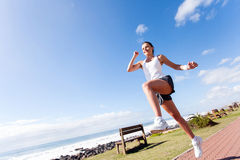 Active young woman running Royalty Free Stock Image
