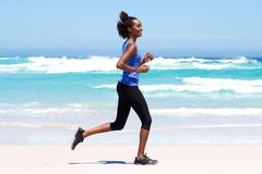 Active young woman running outdoors Royalty Free Stock Images