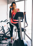 Active young woman running on treadmill at the gym exercising. Run on a machine Royalty Free Stock Image