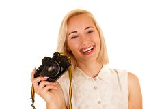 Active young woman taking photos with retro camera isolated over royalty free stock images