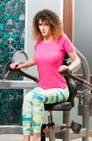 Active young woman training hard her triceps Royalty Free Stock Photography
