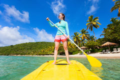 Active young woman on vacation Royalty Free Stock Images