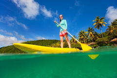 Active young woman on vacation Stock Photography